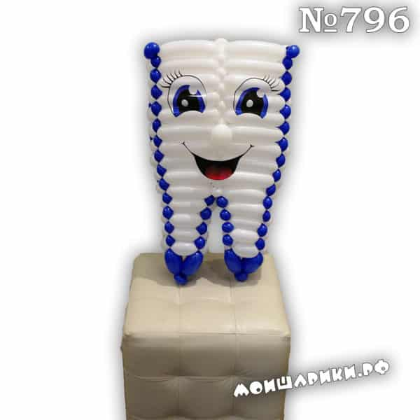 Зуб из воздушных шаров с голубыми глазами
